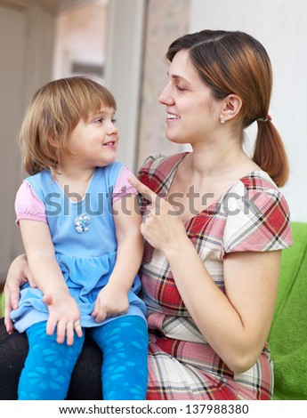 Woman scolds her child in home - stock photo