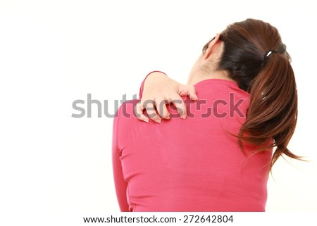 woman scratching her back - stock photo