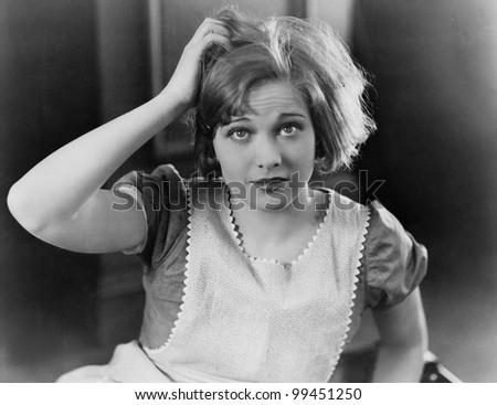 Woman scratching her head - stock photo