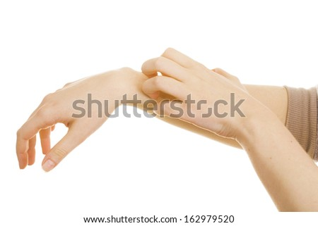 woman scratching her skin because of an allergy - stock photo