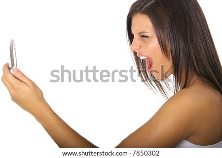 woman screaming at cellphone vertical - stock photo