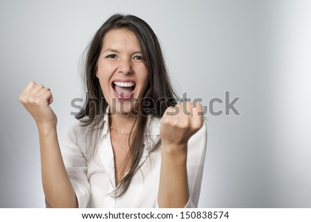 woman screaming because of winning excitement