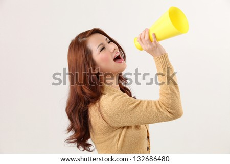 Woman screaming into bullhorn