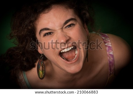 Woman screaming of anger and suffering
