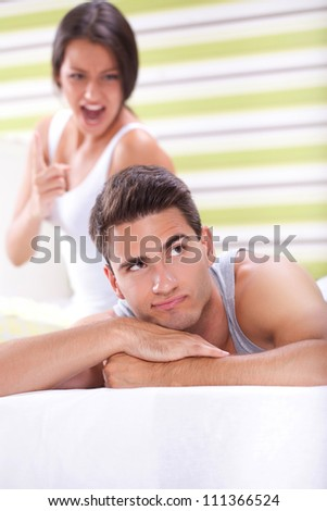 Woman screaming on man , couple having conflict - stock photo