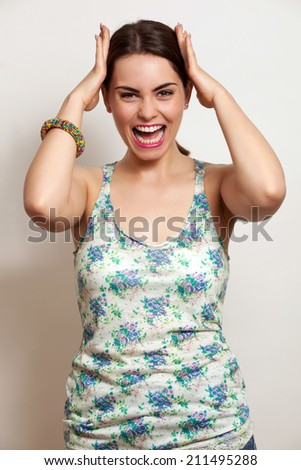 Woman screaming Portrait of angry young woman screaming - stock photo