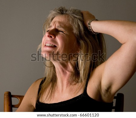 woman screaming, suffering in pain and anger - victim of domestic violence - stock photo
