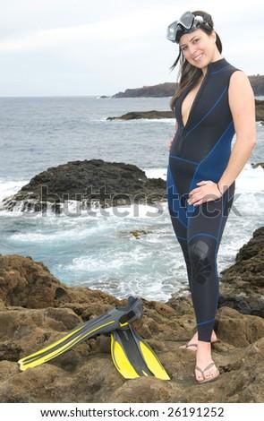 woman scuba diver near the sea - stock photo