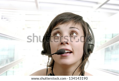 Woman secretary with hands free set answering a call - stock photo