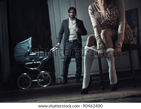 Woman seduces her husband - stock photo