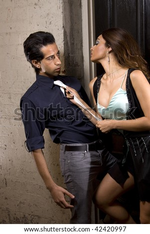 Woman seducing a man in a back alley