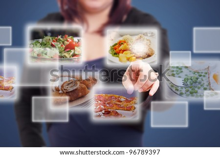 Woman selecting images streaming from the deep - stock photo