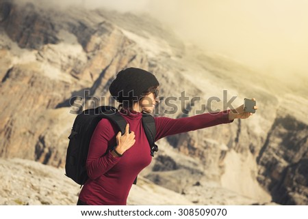 woman selfie on mountain - stock photo