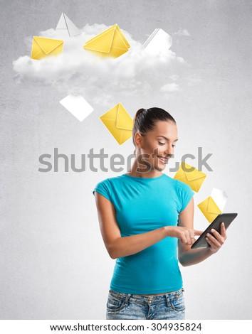 Woman sending data to a cloud - stock photo