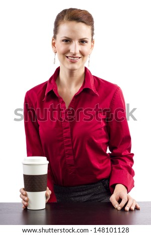 woman serving coffee behind the counter - stock photo
