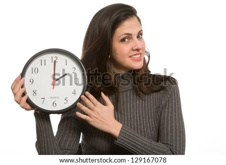 Woman setting clock at daylight savings time. - stock photo
