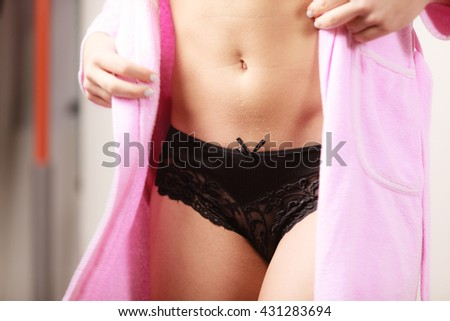 Woman sexy gorgeous alluring model in black luxury stylish lingerie and pink bath robe - stock photo