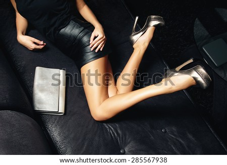 Woman' sexy legs - stock photo