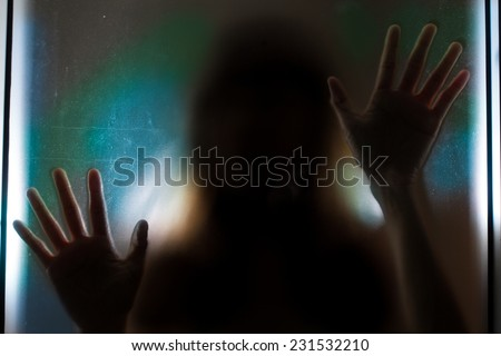 Woman shadow behind translucent mirror.  - stock photo