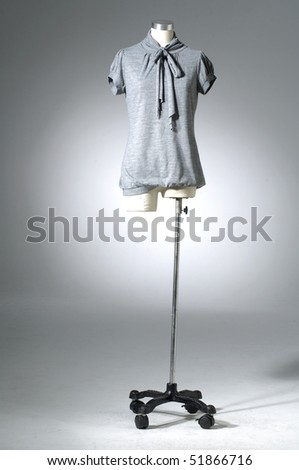 Woman shirt on mannequin on light background