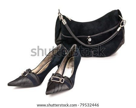 Woman shoes and handbag against white background