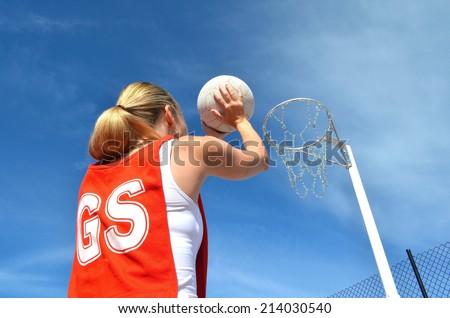Woman Shoots a Netball Goal - stock photo