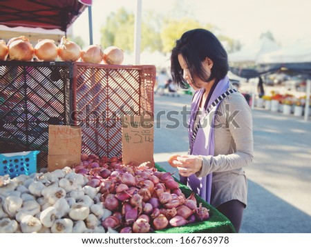 Woman shopping at outdoor market.  - stock photo