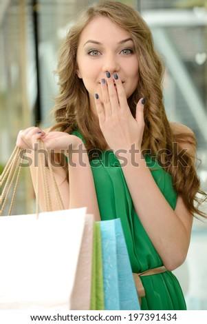 Woman shopping. Beautiful young woman shopping in mall - stock photo