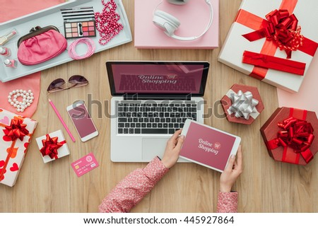 Woman shopping beauty and fashion products online and making mobile payments, e-commerce and technology concept