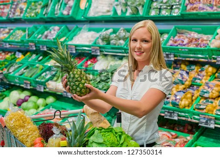 woman shopping for fruit and vegetables in a supermarket shelf freshness - stock photo