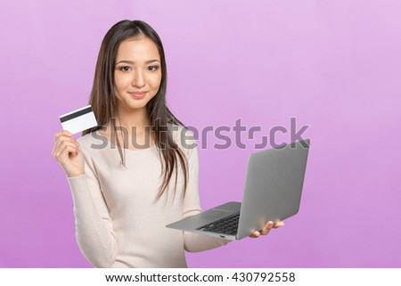 Woman shopping on computer with credit card