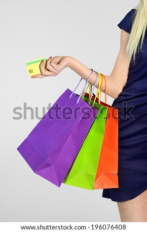 Woman shopping on grey background