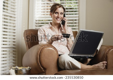 Woman Shopping Online - stock photo