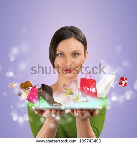Woman shopping online using her tablet computer