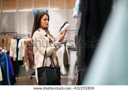 Woman shopping trendy foo tware - stock photo