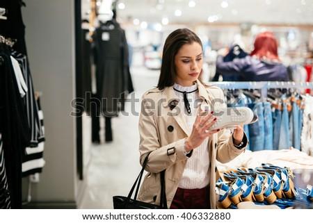 Woman shopping trendy footware - stock photo