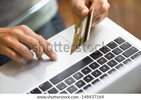 Woman shopping using laptop at home.close-up - stock photo