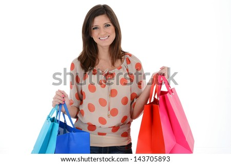 Woman shopping with bags on white background