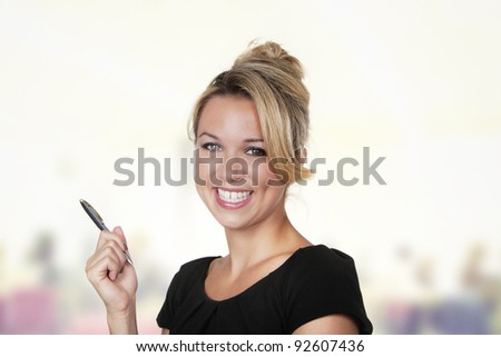 woman shot in the studio on white background holding a pen - stock photo