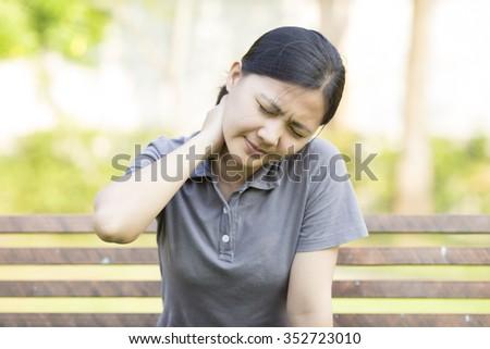 Woman: Shoulder Pain at Park - stock photo