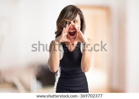 Woman shouting on unfocused background