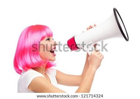 Woman shouting through megaphone - stock photo