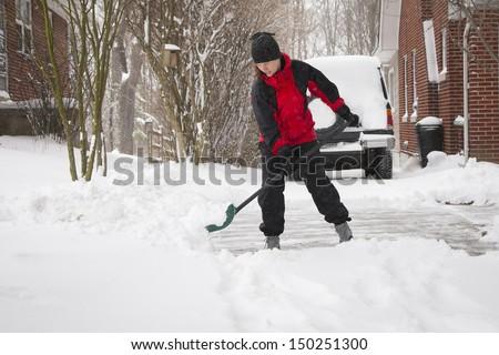 Woman Shoveling Winter Snow - stock photo