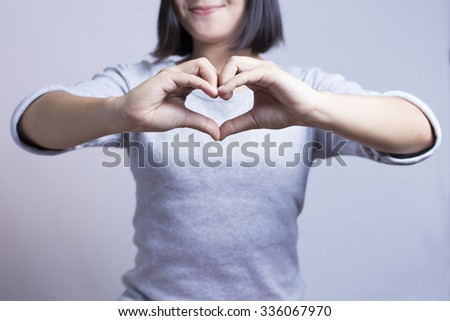 Woman show heart hands - stock photo