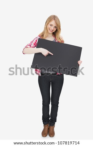 Woman showing a black board against a white background - stock photo