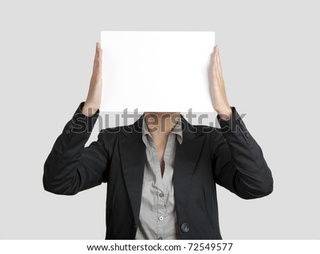 Woman showing a blank paper sheet in front of her head
