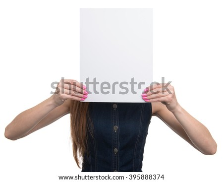 Woman showing a blank paper sheet in front of her head. Isolated - stock photo
