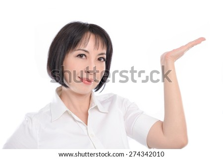woman showing a product - empty copy space on the open hand palms - stock photo