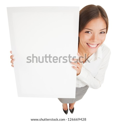 Woman showing a white board sign poster. High angle shot of attractive smiling woman with a blank white board isolated on white background. Mixed race Asian Caucasian business woman smiling happy. - stock photo