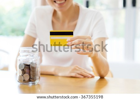 woman showing blank credit card. Focus on card. And savings